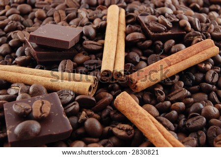 Cinnamon and chocolate on coffee beans