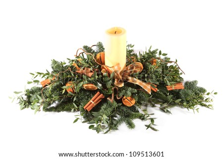 Cinnamon and oranges Christmas table decoration shot in a studio - stock photo