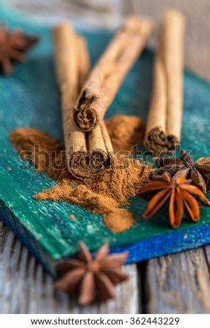 Cinnamon and star anise - Christmas spices on an old wooden table. - stock photo