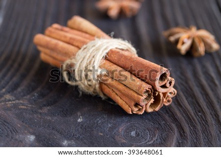 cinnamon and star anise on a wooden background . close-up.