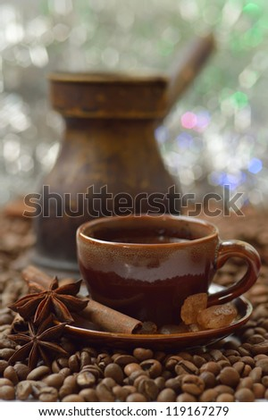 Cinnamon, anise and coffee beans with a cup of coffee - stock photo