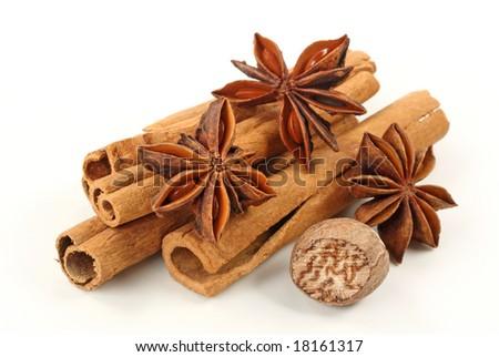 Cinnamon,anise and nutmeg isolated on white background - stock photo