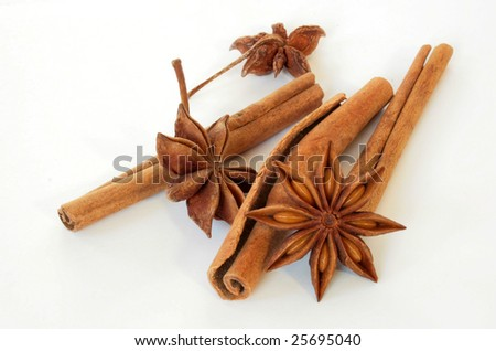 cinnamon bark  and anise stars on white background