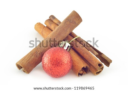 Cinnamon bark (cinnamon) with Christmas ball close-up - stock photo