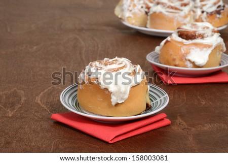 cinnamon bun on a plate - stock photo