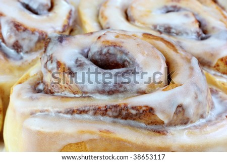 Cinnamon buns in an extreme macro close up using selective focus on foreground bun. - stock photo