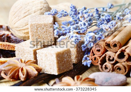 Cinnamon, cocoa, anise and cloves on wooden table - stock photo