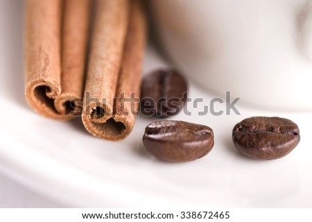 Cinnamon, Coffee Beans, Saucer and Cup - Close Up - stock photo