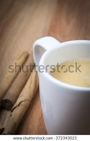 Cinnamon Coffee in a wooden background - stock photo