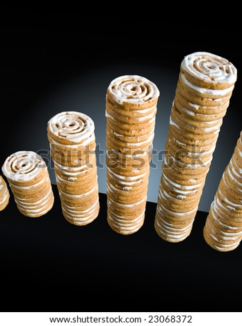 cinnamon cookies stacked like coins (illustration of growth) - stock photo