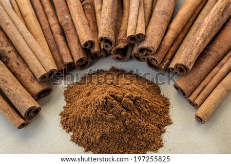 Cinnamon is a spice obtained from the inner bark of several trees from the genus Cinnamomum - stock photo