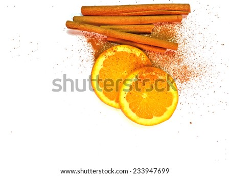 cinnamon powder and stick - orange slices isolated - stock photo