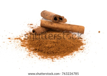 cinnamon powder with sticks isolated on a white background