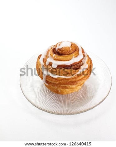 cinnamon roll isolated on white - stock photo