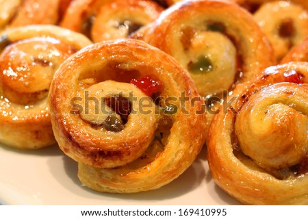 cinnamon roll on buffet line - stock photo