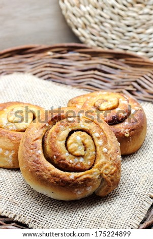 Cinnamon rolls (also Coffee scroll, cinnamon bun, cinnamon swirl, cinnamon snail and kanelbullar in Sweden) - stock photo