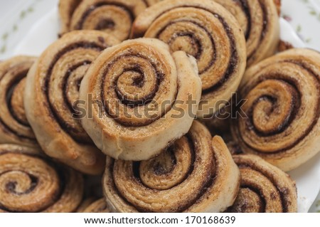 cinnamon rolls and cup of milk - stock photo