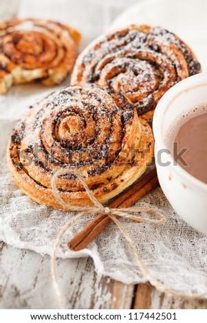 cinnamon rolls with cocoa - stock photo