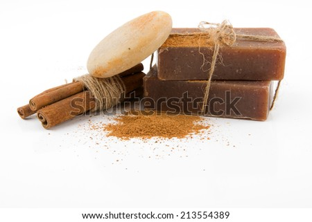 cinnamon soap with ingredients on white background - stock photo