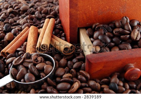 Cinnamon spices, coffee beans, spoon and handmill