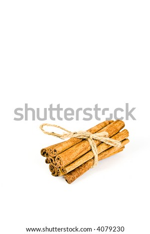 cinnamon spicy sticks close-up isolated over a white  background