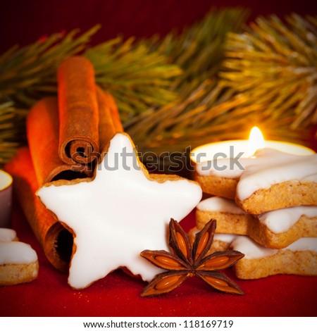 Cinnamon star and cinnamon sticks at christmas - stock photo