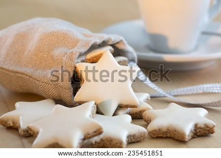 Cinnamon stars falling out a small bag - stock photo