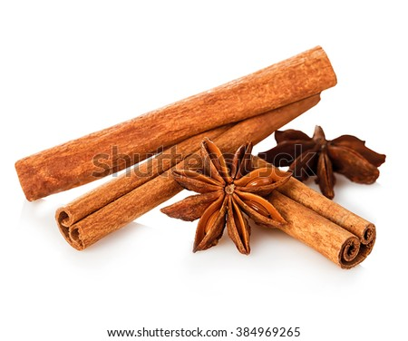 Cinnamon stick and star anise spice close-up isolated on white background. - stock photo