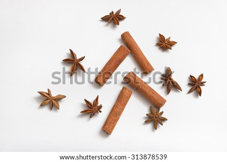 Cinnamon sticks and anise stars - stock photo