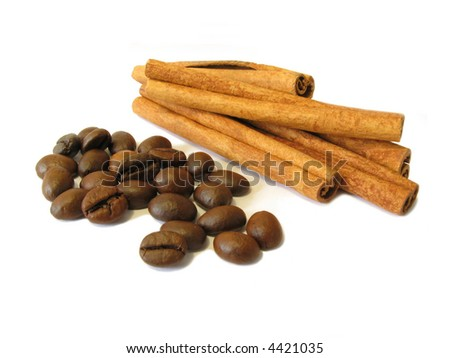 Cinnamon sticks and coffee beans with shadow on a white background