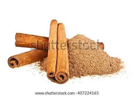 Cinnamon sticks and powder on white background - stock photo
