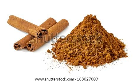 Cinnamon sticks and powder pile on white background - stock photo