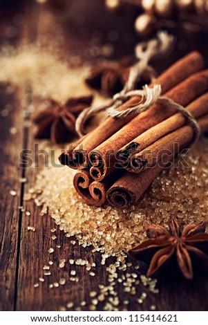 Cinnamon sticks and star anise on brown sugar - stock photo