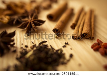 Cinnamon sticks and star anise on wooden  - stock photo