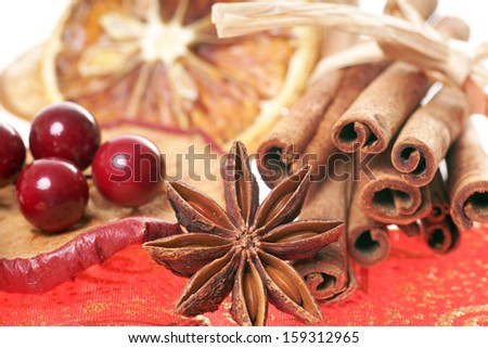 Cinnamon sticks and star anise with orange and apple slices / christmas time
