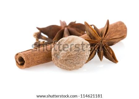 cinnamon sticks, anise star and nutmeg isolated on white background - stock photo