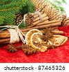 cinnamon sticks, anise stars and sliced of dried orange. christmas decoration. selective focus - stock photo