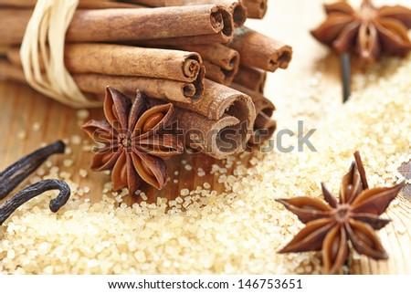 Cinnamon sticks, brown sugar, anise stars and vanilla beans - stock photo