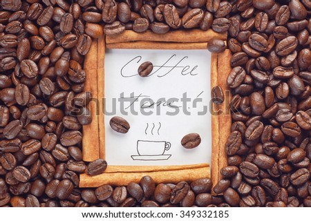 Cinnamon sticks frame with handwritten words Coffee Time on white paper sheet inside surrounded by scattered coffee beans top view