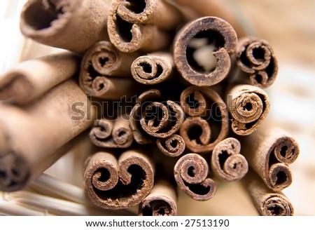 cinnamon sticks in basket - stock photo