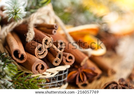 Cinnamon sticks in basket for Christmas day.  - stock photo