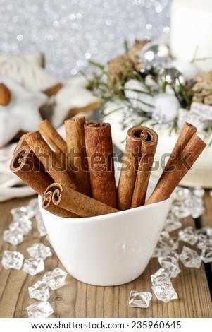 Cinnamon sticks in christmas setting  - stock photo