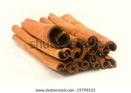 Cinnamon sticks isolated on white - stock photo