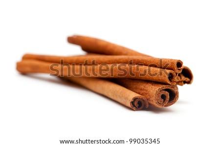 cinnamon sticks isolated on white background - stock photo