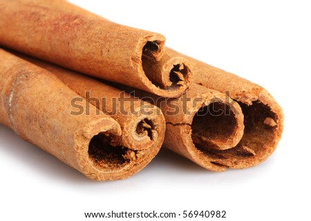 Cinnamon sticks isolated on white background. Shallow DOF - stock photo