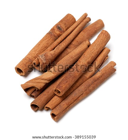 Cinnamon sticks isolated on white background. Top view. - stock photo