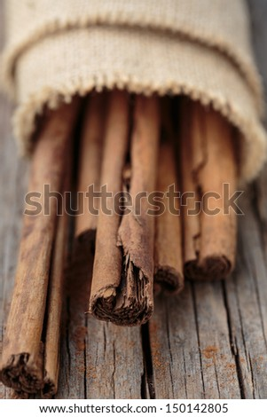 Cinnamon sticks on wooden background.  - stock photo