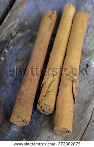Cinnamon sticks on wooden background - stock photo