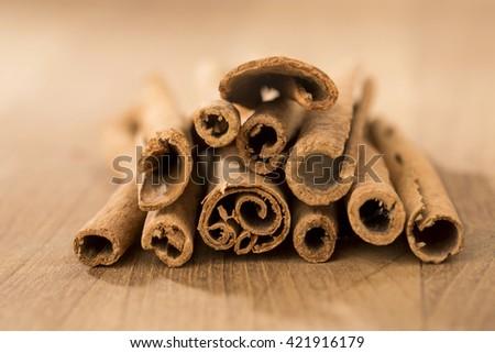 cinnamon sticks on wooden table. - stock photo