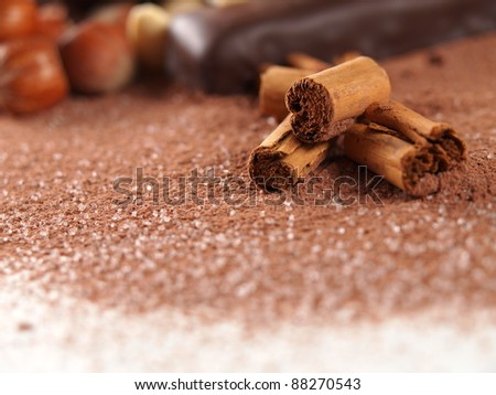 cinnamon sticks over cocoa powder - stock photo